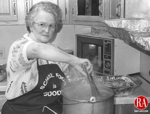 Shirley Mason Bread for Life stirs a pot of gravy